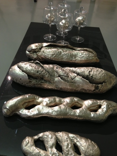 installation view of cast Bronze and Silver Platted Breads on stainless Steel table (1 0f 5 tables)
