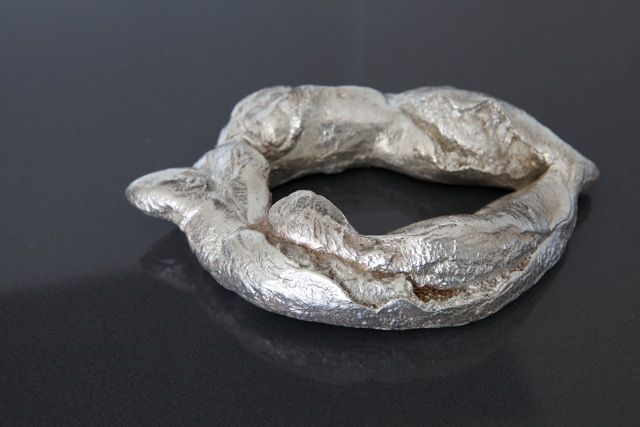 Title- 6 Dinar , cast Bronze Bread sculpture and Silver platted, life size.